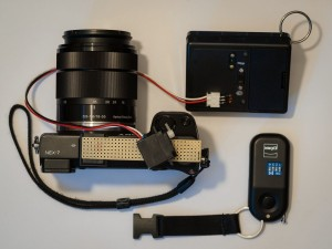 Sony NEX-7 with attached trigger, controller box, radio transmitter